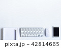 White desk office with laptop, smartphone and othe 42814665