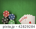Gambling chips and card for poker on green felt background 42829284