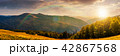 panorama of a mountainous landscape at sunset 42867568