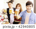 happy young friends drinking beer in  restaurant. 42940805