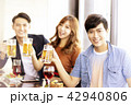 happy young friends drinking beer in  restaurant. 42940806