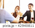 happy young friends enjoy dinner in  restaurant. 42940811