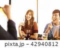 happy young friends enjoy dinner in  restaurant. 42940812