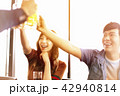 happy young friends drinking beer in  restaurant. 42940814