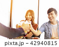 happy young friends drinking beer in  restaurant. 42940815