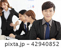 business man  with colleagues on background 42940852
