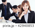 business woman  with colleagues on background 42940853
