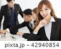 business woman  with colleagues on background 42940854
