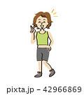 フィットネスウェアを着てピースをする中年女性 42966869