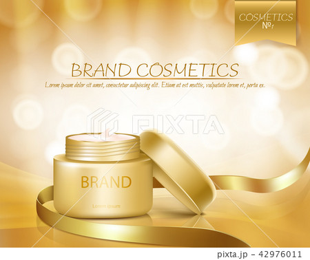 Gold jar with open lid is full of cosmetic cream 42976011