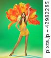 young beautiful dancer posing on studio background 42982285