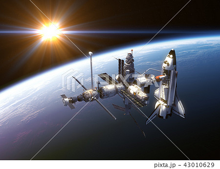 Space Shuttle And Space Station In The Rays Of Sun 43010629