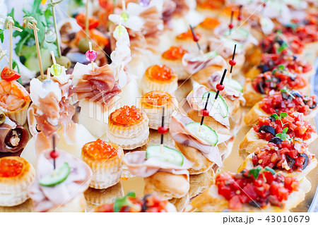 catering banquet table with different food snack 43010679