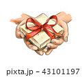 Female hands holding a small gift wrapped with red ribbon 43101197
