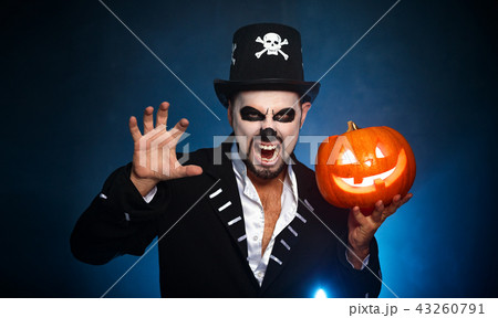 halloween. magic skeleton with  pumpkin. man in makeup and  cost 43260791