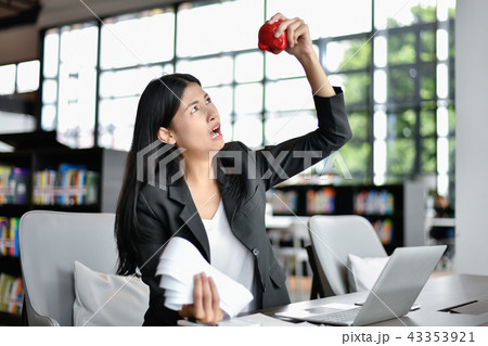 Business concept. Young business woman is stressed about her exp 43353921