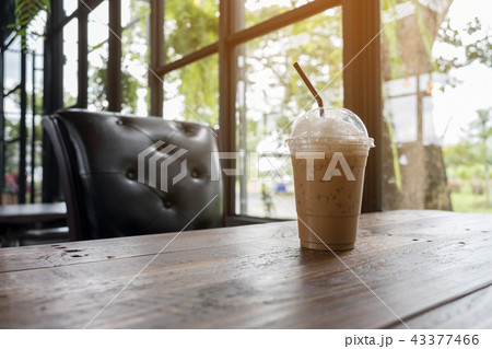 Iced cappuccino on wooden table beside in coffee 43377466