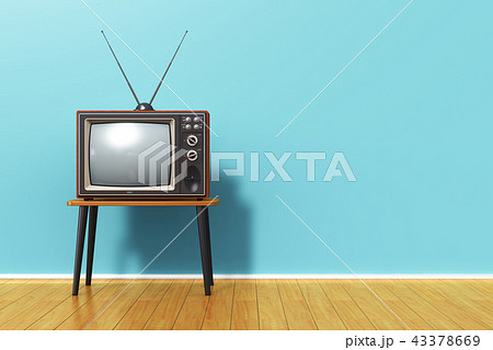 Old retro TV against blue vintage wall in the room 43378669