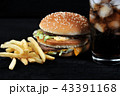 burger with french fries and a glass with ice cola 43391168