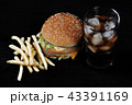 burger with french fries and a glass with ice cola 43391169