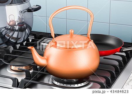 Copper kettle on the gas stove in kitchen interior 43484623