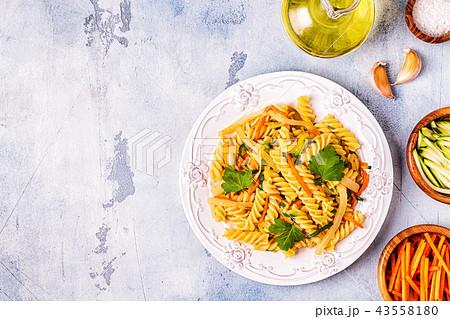 Fusilli pasta with squid, zucchini and carrots 43558180