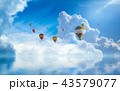 Hot air balloons fly in blue sky 43579077