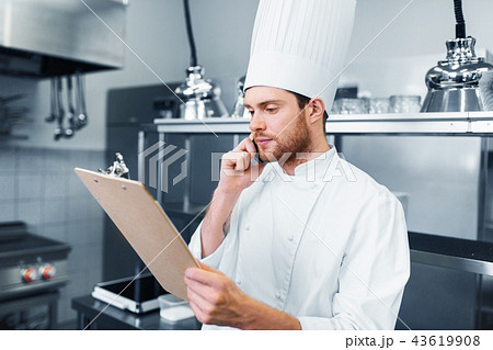 chef cook calling on smartphone at restaurant kitchen 43619908