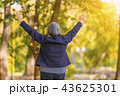 Happy woman with arms outstretched 43625301