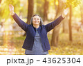 Happy woman with arms outstretched 43625304