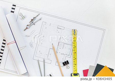 Interior designer table workplace with house plan 43643405