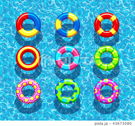 Pool rings on blue water background 43673080