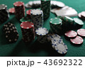 Poker chips and cards on the cloth 43692322