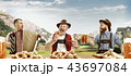 Germany, Bavaria, Upper Bavaria, men with beer dressed in traditional Austrian or Bavarian costume 43697084