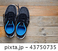 Sneakers on wooden background top view 43750735
