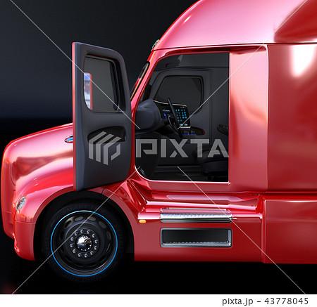 電動トラックキャビンの側面イメージ。ドアが開かれ、ダッシュボードとステアリングが見える 43778045
