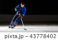 Young hockey player skating on rink in attack 43778402