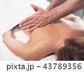 Masseur doing therapeutic massage on lady back 43789356