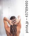 Beautiful naked lady washing hair at bathroom 43789460