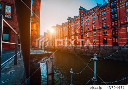 A red brick multi-storey houses of Speicherstadt Hamburg. Famous landmark of old red brick buildings 43794431