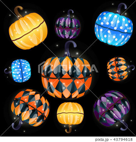 Set of colorful boxes with a fun texture made in the shape of pumpkins isolated on a black 43794618