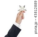 Hand is throwing ninja shuriken 43812889