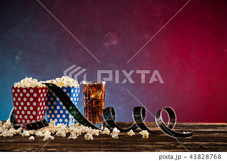 Boxes of popcorn on blue and red background. 43828768