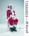 Funny guy in christmas hat. New Year Holiday. Christmas, x-mas, winter, gifts concept. 43849921