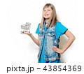 young teenage girl with supermarket cart 43854369
