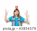 young teenage girl with alarm clock 43854379