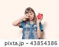 young teenage girl with alarm clock  43854386