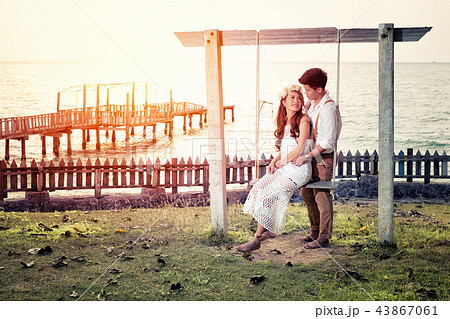 Happy young romantic couple by the beach 43867061