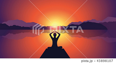 yoga silhouette peaceful sunset at lake and mountains background 43898107