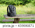Backpack on wooden table outdoors 43906871